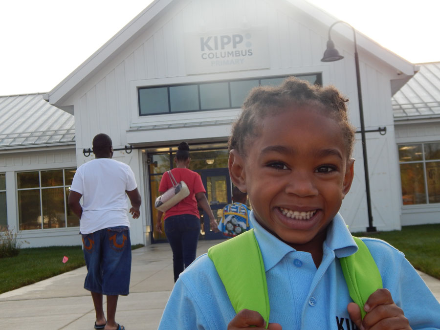 A KIPPster stands in front of KIPP Columbus Primary (KCP) on their first day of school.