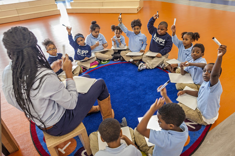 A small group of KIPPsters with an INSPIRE Teaching Fellow during literacy rotations.