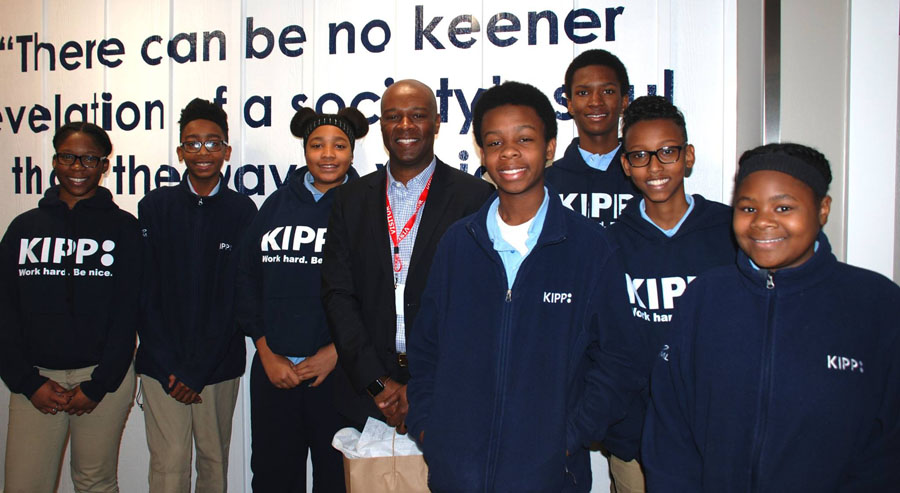 Donald Brown with KIPP Columbus Middle KIPPsters during a Leadership Breakfast.