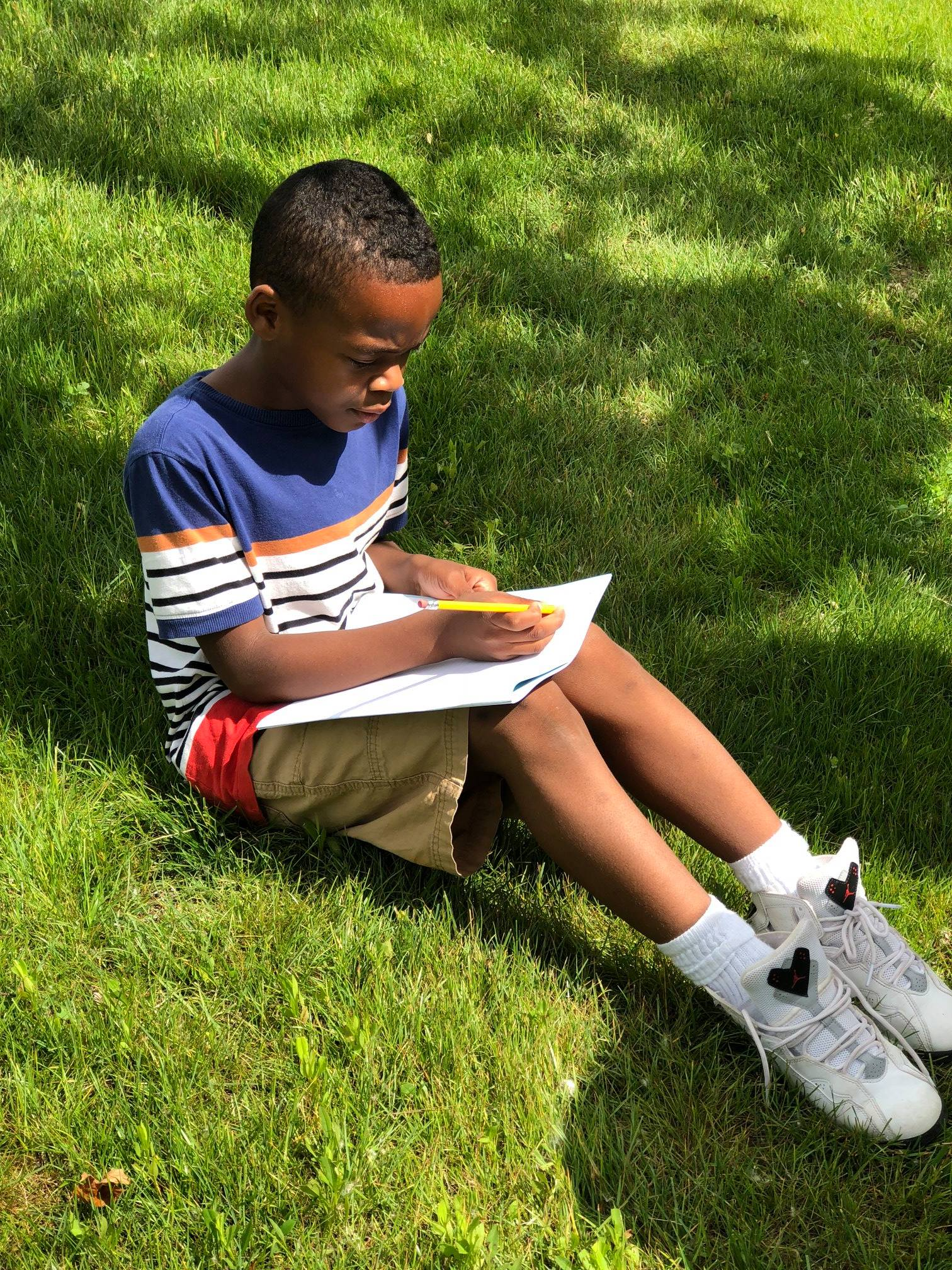 A KIPPster writing observations about the environment