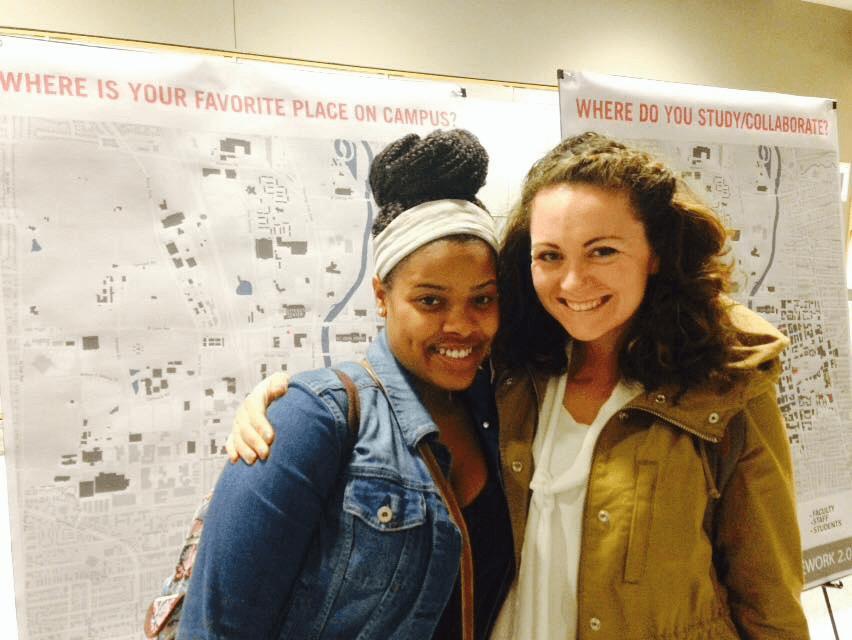 women smiling in hallway